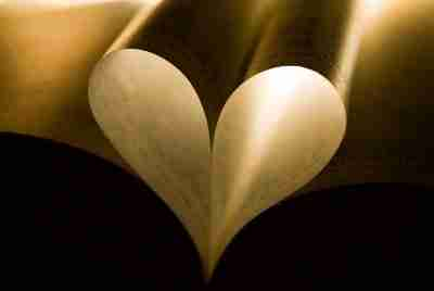 Book pages shaped like a gold heart