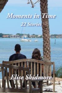 Moments in Time cover, two people sitting on a bench by the water